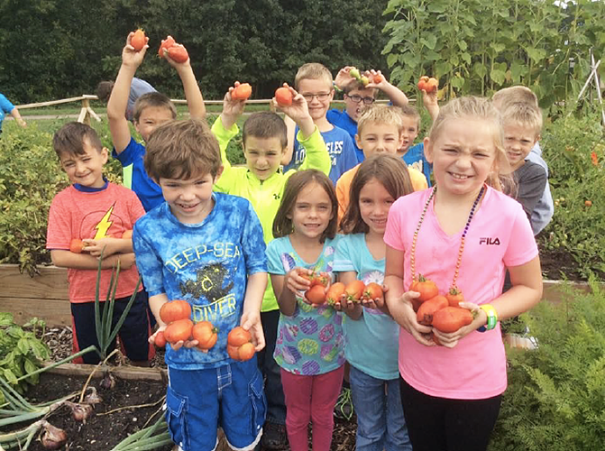 Cannon Falls Kids Holding Tomatoes